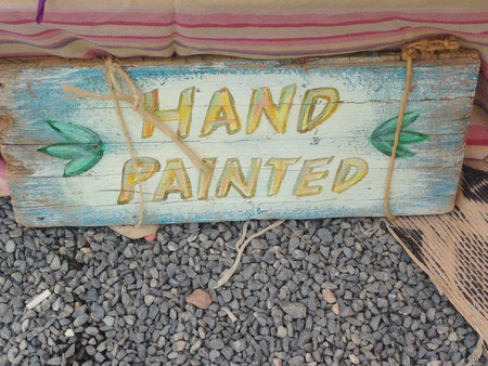 A hand painted sign in the Ibizas Hippy Market