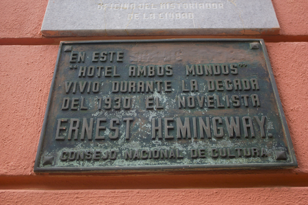 Hotel Ambos Mundos placard with the name of Ernest Hemingway. The Hotel Ambos Mundos (both worlds), opened in 1925, is a historic landmark in the center of the Cuban capital made famous by American writer Ernest Hemingway.