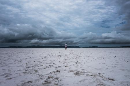 whitehaven beach: Lonely man walking on the beach in Whitehaven Beach, Queensland Australia Stock Photo
