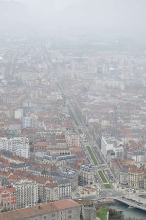 Birds eye view of city of Grenoble, France, on a cold snowy winter day Stock Photo