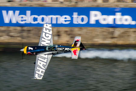 Red Bull Air Race 2017 Porto - Challenger Class plane flying over Welcome to Porto sign Editorial