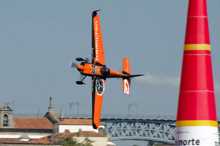 Red Bull Air Race 2017 Porto - Nicolas Ivanoff plane flying vertical pass pylon Editorial