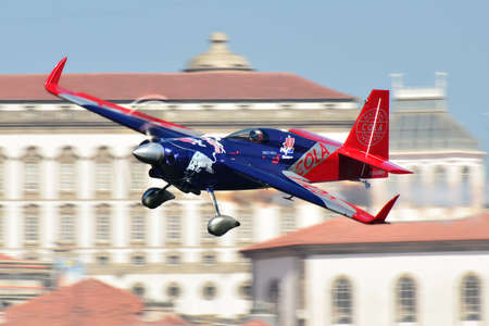 Red Bull Air Race 2017 Porto - Matt Hall plane flying against historic buildings background Editorial
