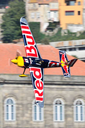 Red Bull Air Race 2017 Porto - Martin Sonka plane flying against historic buildings background Editorial