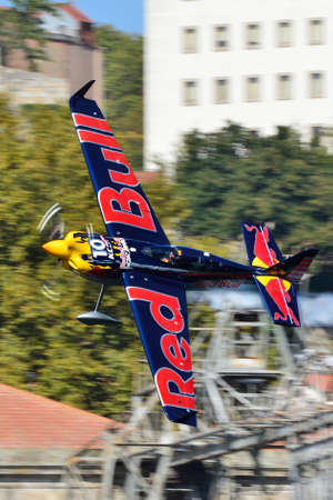 Red Bull Air Race 2017 Porto - Kirby Chambliss plane flying against buildings background