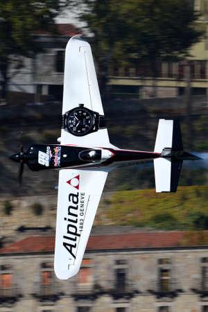 Red Bull Air Race 2017 Porto - Michael Goulian plane flying vertical against buildings background