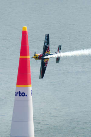 Red Bull Air Race 2017 Porto - Challenger Class plane flying vertical passing pylon Editorial