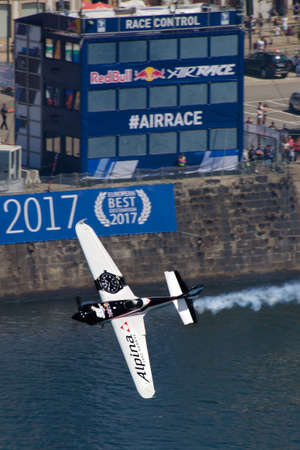 Red Bull Air Race 2017 Porto - Michael Goulian flying pass race control building Editorial