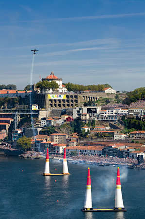 Red Bull Air Race 2017 Porto - Pete McLeod flying panorama against city and audience background