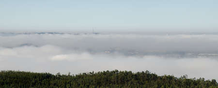 Above the sea of clouds on a mountain in Valongo, Portugal, overlooking Porto Metropolitan Area Stock Photo