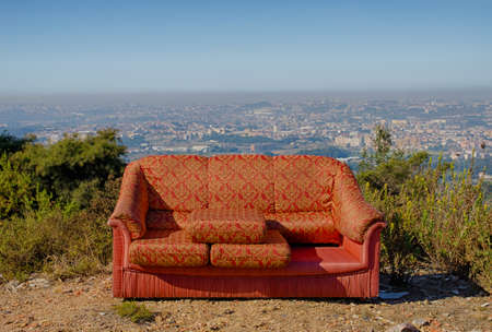 Bold colorful pattern fabric sofa outdoor, overlooking Porto metropolitan area in Portugal Stock Photo