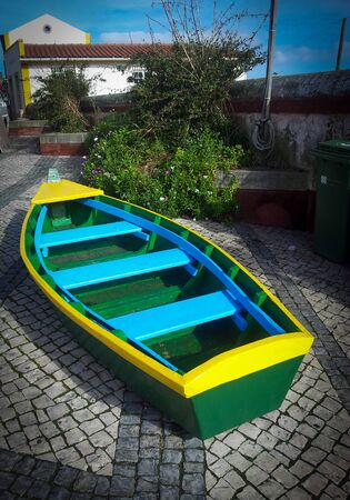 Colored boat in the sidewalk in Obidos, Portugal
