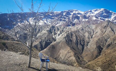 Solitary chair in the middle of Atlas Mountains in Morocco