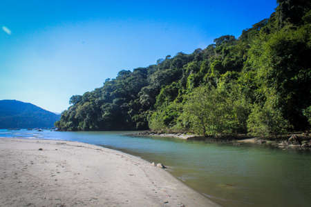 Amazing river going to the beach of Praia do Pereque, Guaruja, Brazil. Tropical forest, clean river