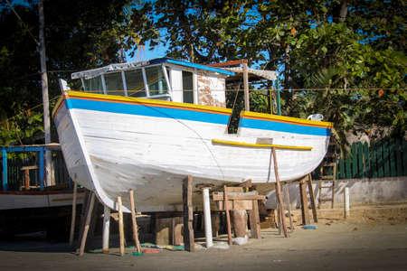 Great white boat in a shipyard in the Praia do Pereque in Guaruja, Brazil
