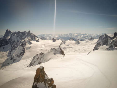 Line of skiers in the Vallee Blanche, Chamonix, France. Very touristic place and sunny day, no clouds
