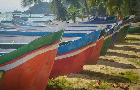 Amazing colored bots in the beach in Ilha Bela, Sao Paulo, Brazil. Summer day, beautiful beach , cool island