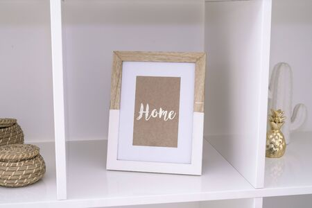 Frame inside a living room with the word home