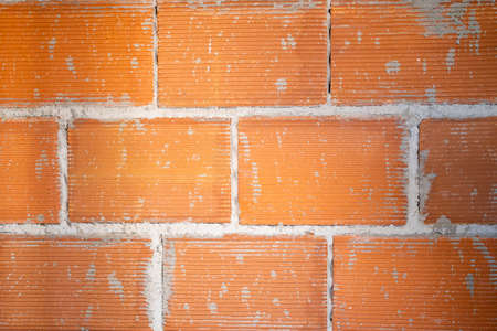 Brickwork background. House or site under construction. Building brick wall structure. Red brick wall