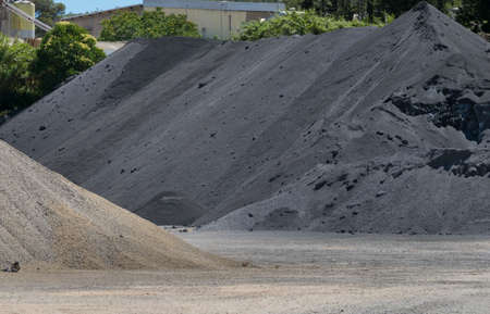extracted: Mineral extraction. Mountains of different materials extracted from the quarry.