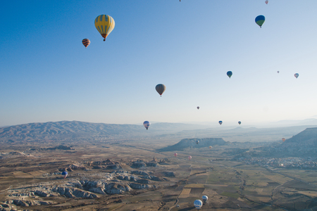 Colorful balloons flying over mountains and with blue sky
