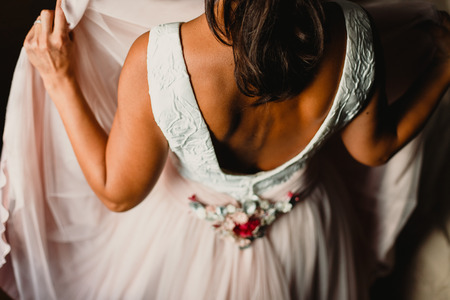 Detail of a white and elegant wedding dress.