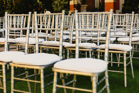 Retro empty vintage style wooden chairs for events and weddings
