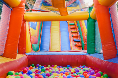 Inflatable castle full of colored balls for children to jump 스톡 콘텐츠