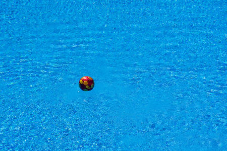 Soccer ball floating in a pool