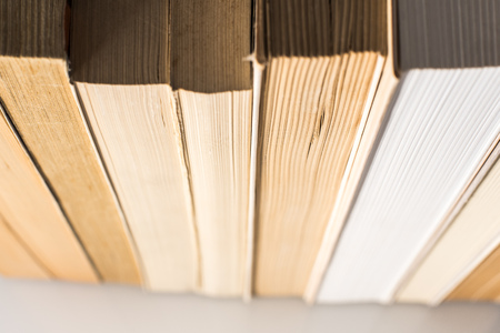 Many stacked books with white background with space