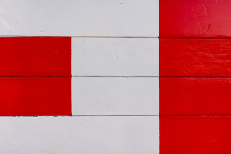 Detail of a painting of red lines on white wooden table. Stock Photo