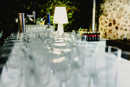 Many glass glasses ready to serve drinks at a party.