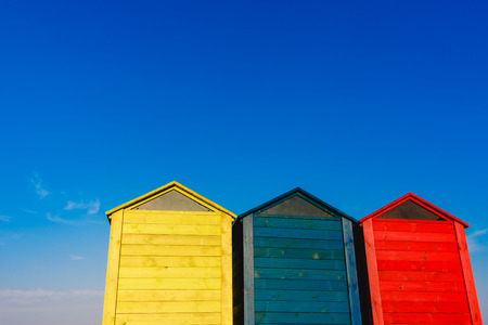 Cabins changers for bathers on a beach of the Mediterranean in summer, colored blue, yellow and red.