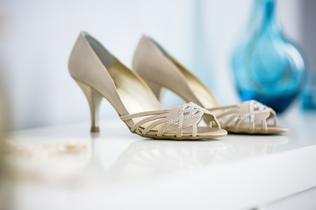 Wedding shoes on their wedding isolated in a room Stock fotó