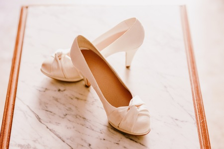 Wedding shoes on their wedding isolated in a room Banco de Imagens
