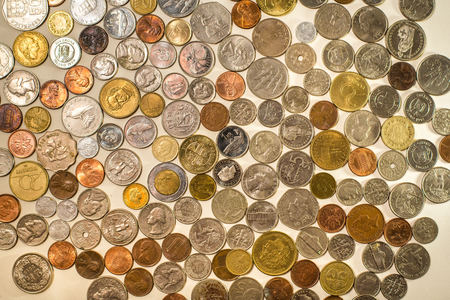 Many coins from different countries of the world