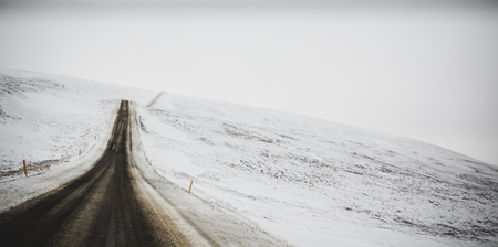 Road trip secondary with snow without anyone driving through Iceland