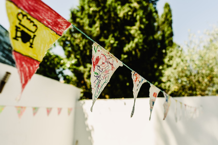 Pennants painted by children to play in summer