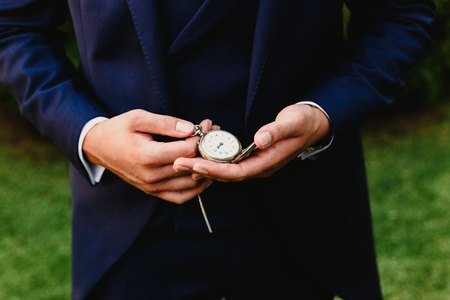 Groom with pocket watch 免版税图像