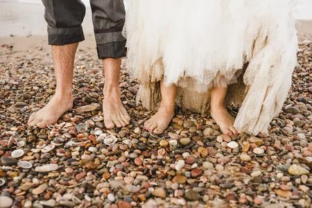 Newlywed couple walking on the beach
