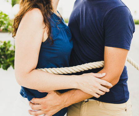 Couple embraced and tied by a rope. Imagens