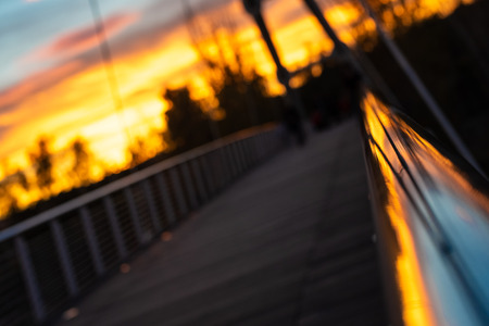 Warm sunset and silhouette of suspended bridge in the city of Valencia, Spain. Archivio Fotografico
