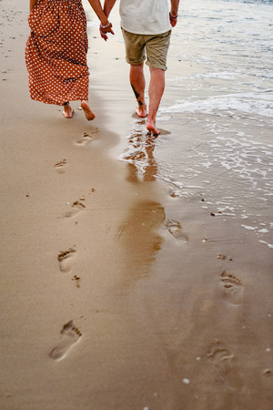 Couple in love playing and walking on the shore of the beach. Banco de Imagens