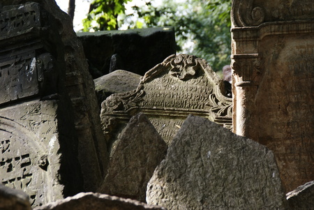 Historic old Jewish cemetery with rock tombs in Prague and broken monuments by the passage of time Stock Photo