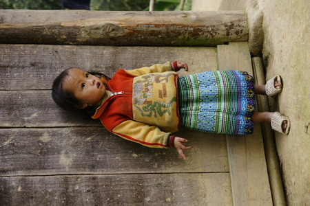 Sapa, Vietnam - August 10, 2018: Children from villages in the mountainous area of Sapa, north of Vietnam, expecting to see Western tourists. Editorial