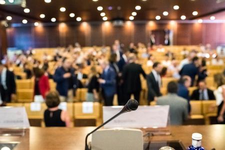 People attending congress sitting in seats Standard-Bild - 114352206
