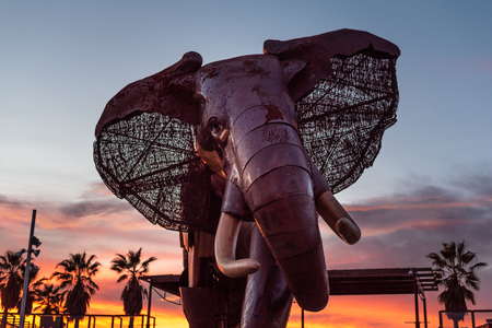 Valencia, Spain - December 15, 2018: Giant wooden and metal elephant at the entrance of the Bioparc zoo in Valencia, Spain, at the time of zoo closing, just at sunset. 写真素材