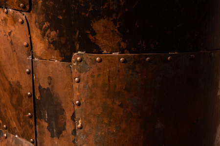 Rusted steel plates joined with rivets