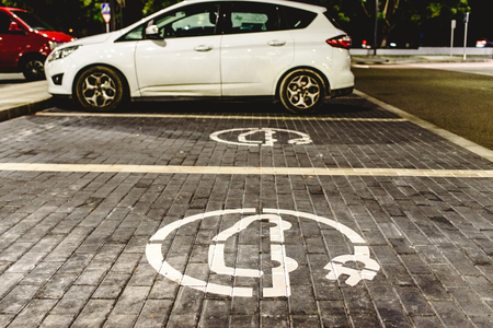 Refill station signal for electric vehicles painted on the ground.