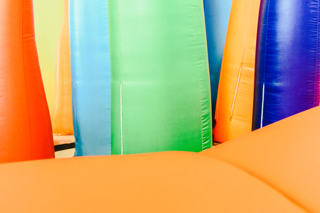 Detail of inflatable castles with shapes of flames of giant colors Stock Photo